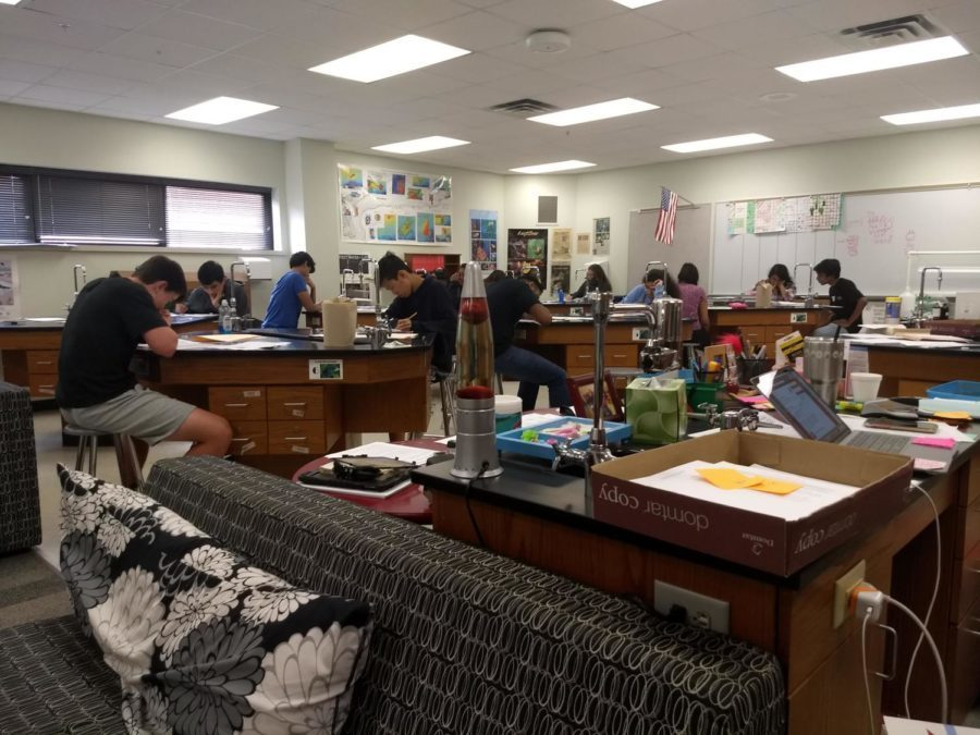 Coppell High School AP Environmental Science students who are taking the AP exam on May 7 do a practice test in AP/IB Environmental Science teacher Holly Anderson's room. The new AP exam policy will allow students taking the AP exam to be exempt from that class' final exam.