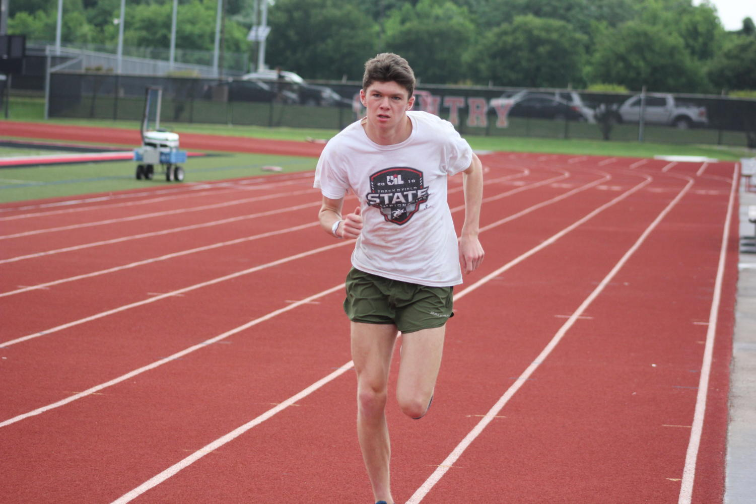 Coppell High School junior Jackson Walker practices running before school Tuesday morning at the Buddy Echols Track. Walker is preparing for the state track meet this weekend.