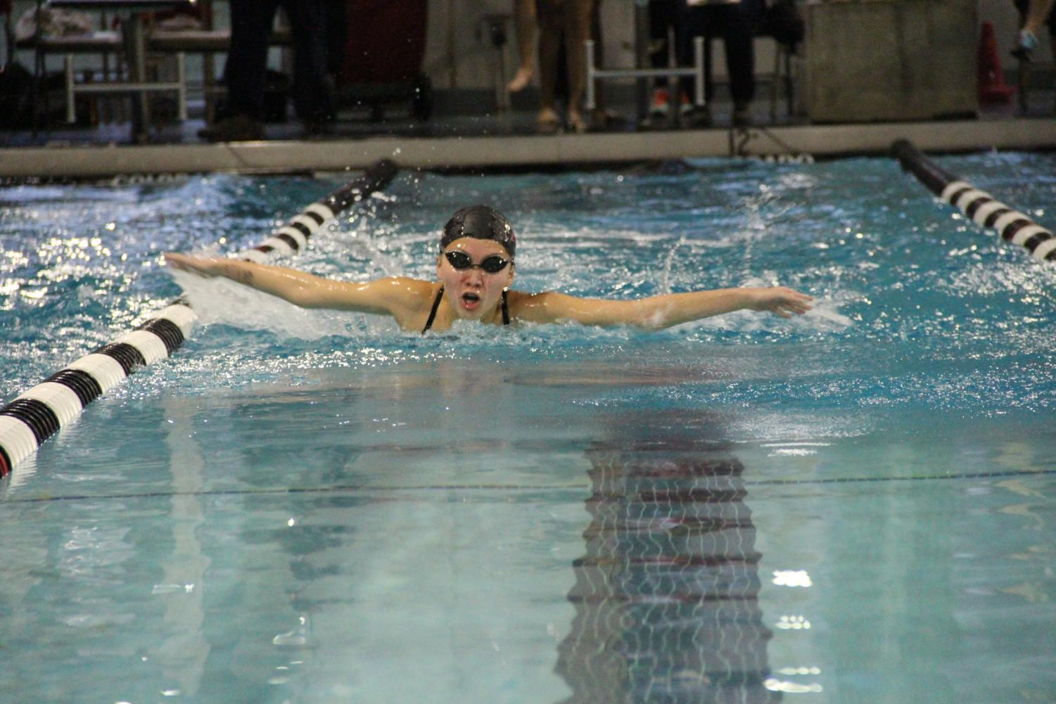 "Coppell High School sophomore Megan Li swims at the intrasquad ""Vaquero Battle"" meet in November. The meet on May 2-4 will consist of scrimmages between CHS swimmers and culminate in a competition with J.J. Pearce High School."
