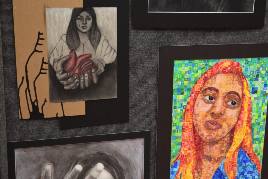CHS AP/IB students showcase their art on display on Thursday night in the CHS Commons. Students who are involved in AP/IB art classes have worked on their pieces all year and showcase their artwork on tables and on display.