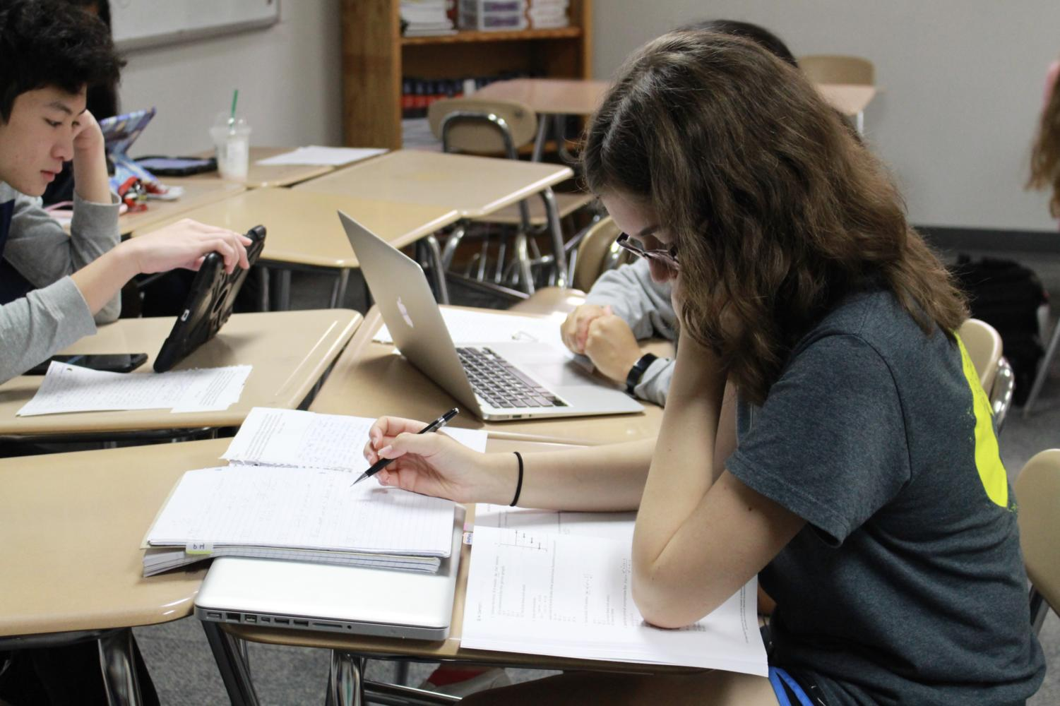 Coppell High School junior Emilie Sangerhausen prepares for her AP exam in Eligio Mares' fifth period AP Spanish Language and Culture class on Monday. Students are preparing by studying for the upcoming exams tomorrow morning.
