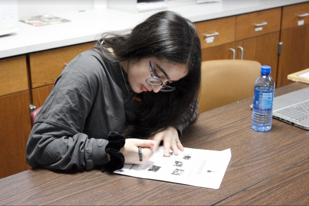 The Sidekick staff writer Umama Suriya edits May issue pages during fifth period on May 10. Suriya states after moving back to Coppell from Round Rock, journalism helped her build the confidence she had once lost. Photo by Gabby Nelson.