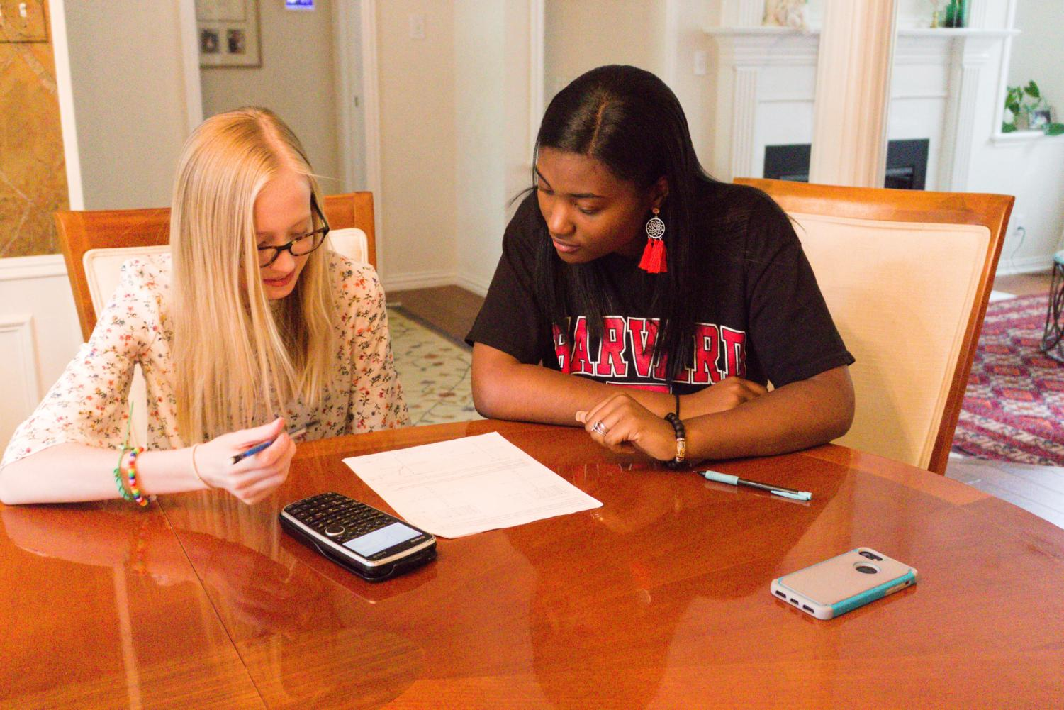 Coppell High School senior Peyton Williams tutors CHS sophomore Lauren Myers for Algebra II on April 22 at Myer's residence. Williams has tutored students in a variety of subjects throughout high school and is attending Harvard University in fall 2019.