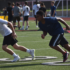 Athletes run drills at Solomon Thomas Youth Football Camp