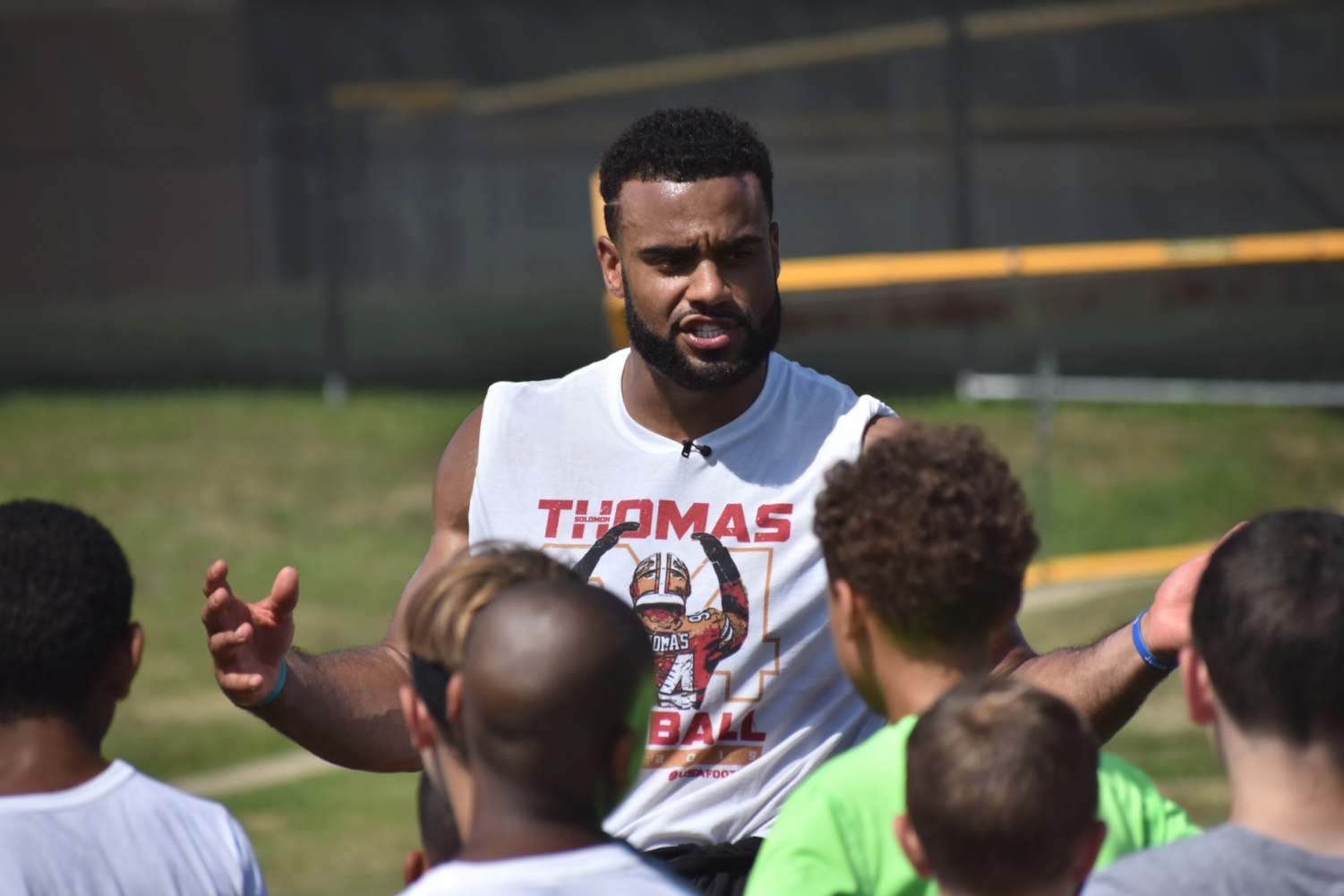 San Francisco 49ers defensive end and Coppell High School 2014 graduate Solomon Thomas gives instructions for a group of campers attending the Solomon Thomas Youth Football Camp. The three-hour camp consisted of rotating stations for kids ages 8-16 and took place at Buddy Echols Field on Saturday morning.