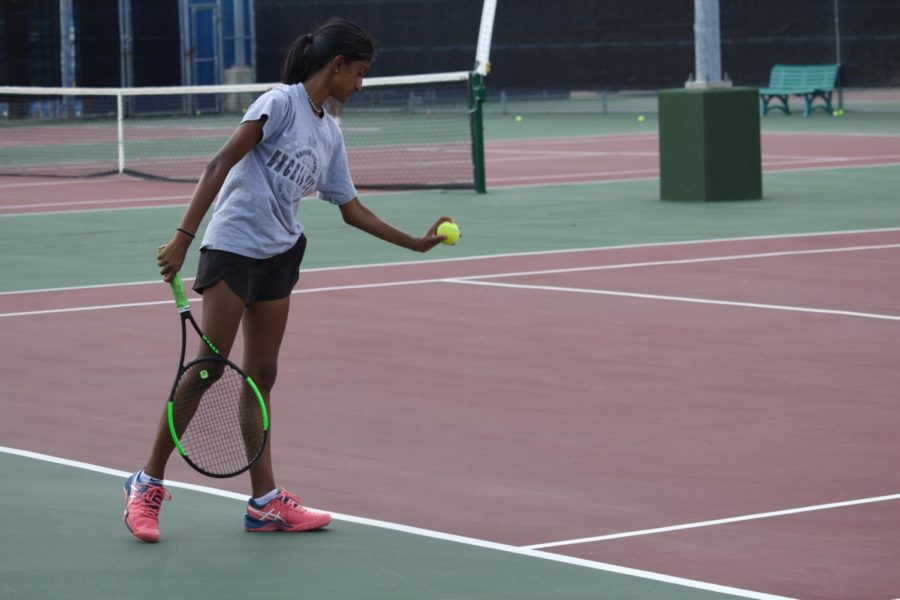 Coppell senior Aishwarya Kannan serves during practice on Thursday. The Coppell tennis team practices every day in order to prepare for their upcoming tournament against Hebron on Tuesday at the CHS Tennis Center.
