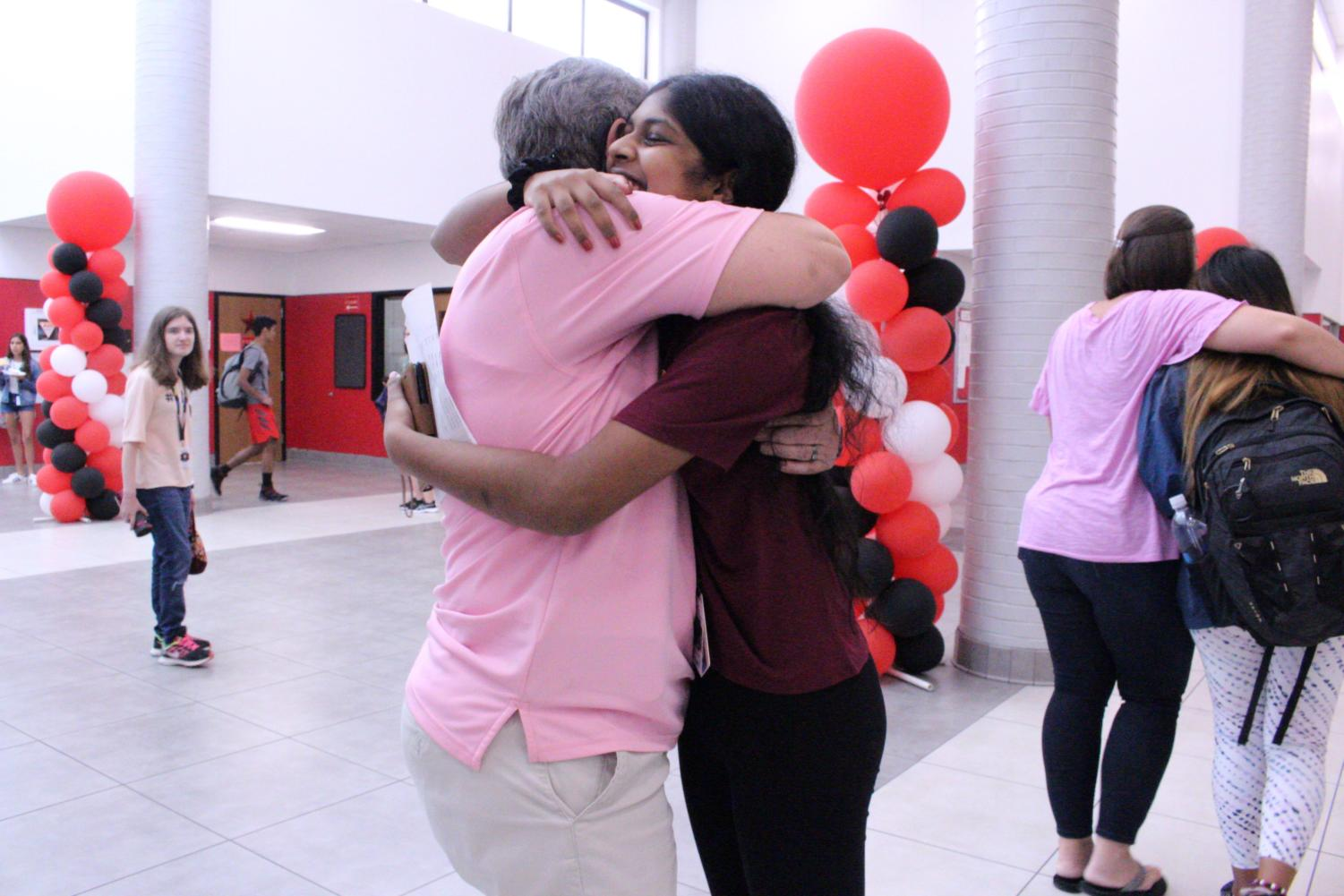Coppell High School Principal Laura Springer hugs CHS sophomore Megna Gopinath as a sign of welcoming to the new school year. Springer comes to CHS from Coppell Middle School East and is bringing several changes to the campus.