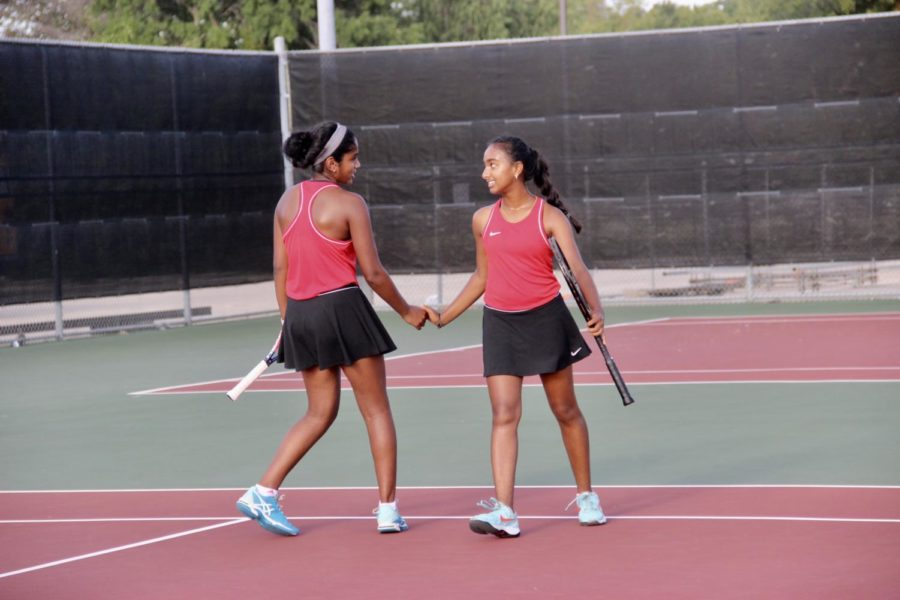 Coppell+High+School+freshman+Lakshana+Parsuraman+and+sophomore+Nandini+Thallapareddy+congratulate+each+other+for+making+a+break+on+Friday+during+the+first+round+of+the+Highland+Park%2FPlano+West+tournament.+Later+in+the+tournament%2C+Coppell+defeated+Southlake+Carroll+for+the+first+time+in+seven+years.