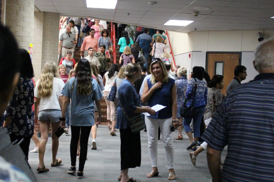 Coppell High School parents travel from class to class at the 2018 Open House. This year, Open House will be tonight from 6-8 p.m.