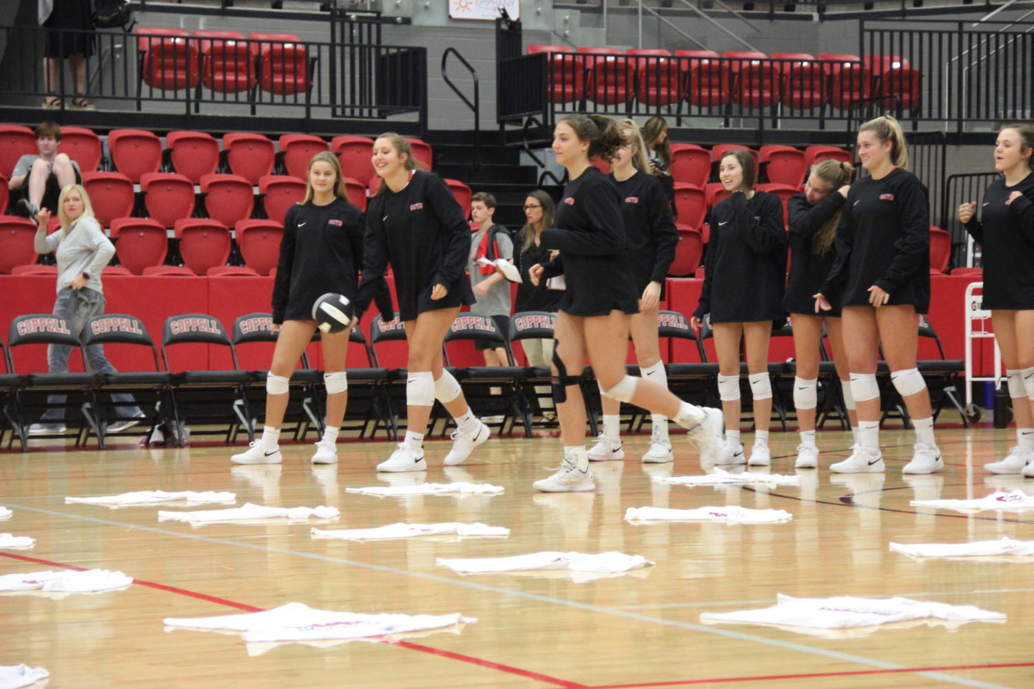 Coppell+varsity+volleyball+players+distribute+T-shirts+to+elementary+school+students+who+successfully+serve+during+Elementary+Night.+The+Coppell+volleyball+team+hosted+Elementary+Night+on+Tuesday+in+the+CHS+Arena+before+the+varsity+match+against+Arlington+Martin.+