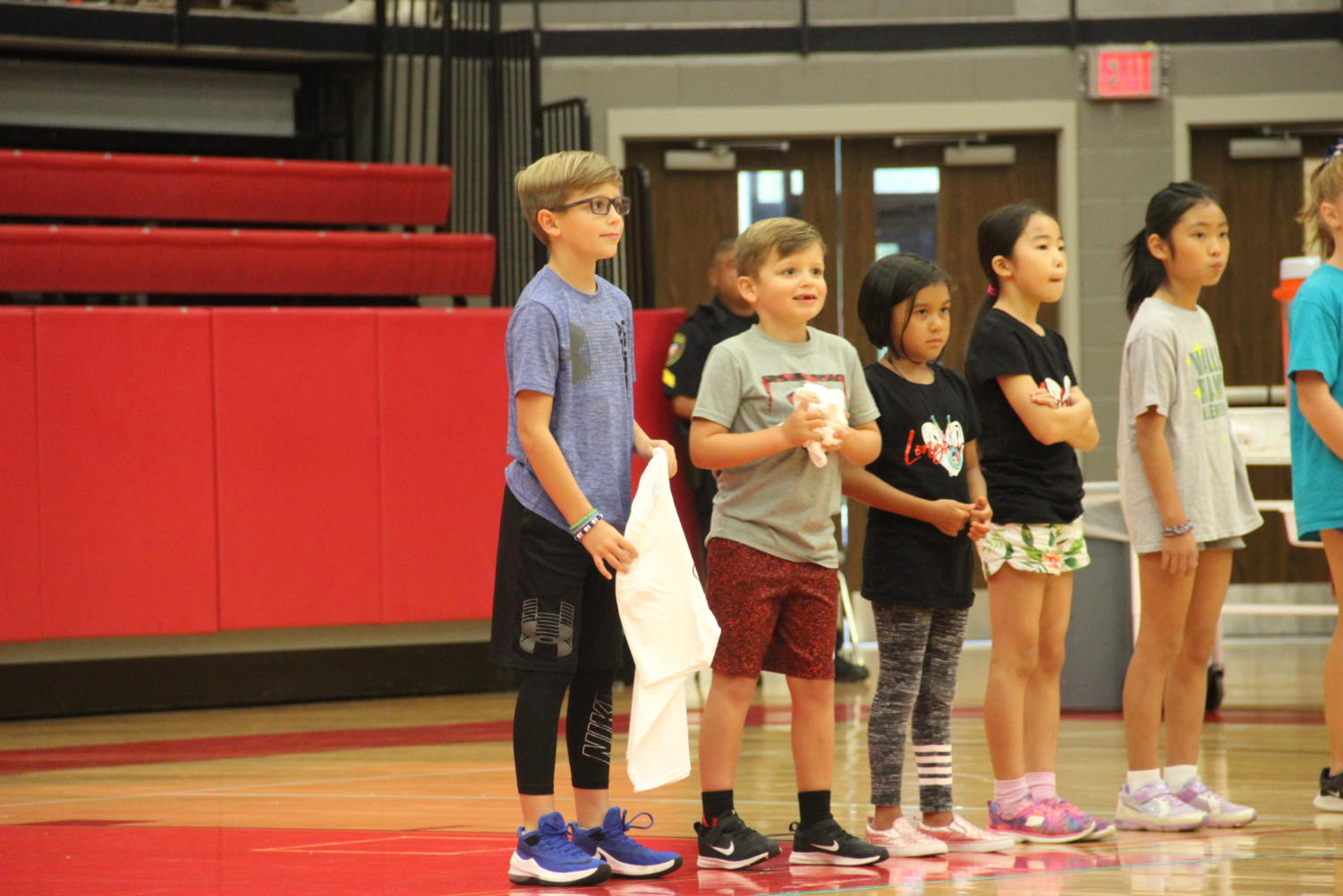 Elementary+school+students+celebrate+after+winning+T-shirts+from+successfully+serving.+The+Coppell+volleyball+team+hosted+Elementary+Night+on+Tuesday+in+the+CHS+Arena+before+the+varsity+match+against+Arlington+Martin.