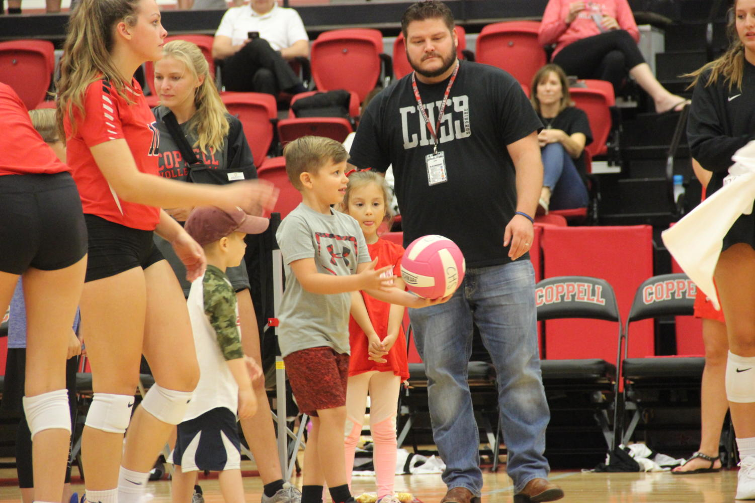 Elementary+school+students+attempt+to+hit+and+win+T-shirts+in+the+CHS+Arena.+The+Coppell+volleyball+team+hosted+Elementary+Night+on+Tuesday+before+the+varsity+match+against+Arlington+Martin.
