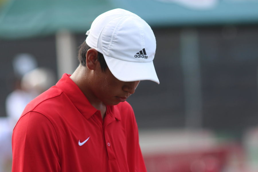 Coppell+junior++Matthew+Abbey+prepares+to+serve+for+his+match+against+Southlake+Carroll+at+the+CHS+tennis+courts+on+Wednesday.+Coppell+played+the+Dragons+and+lost+13-6.
