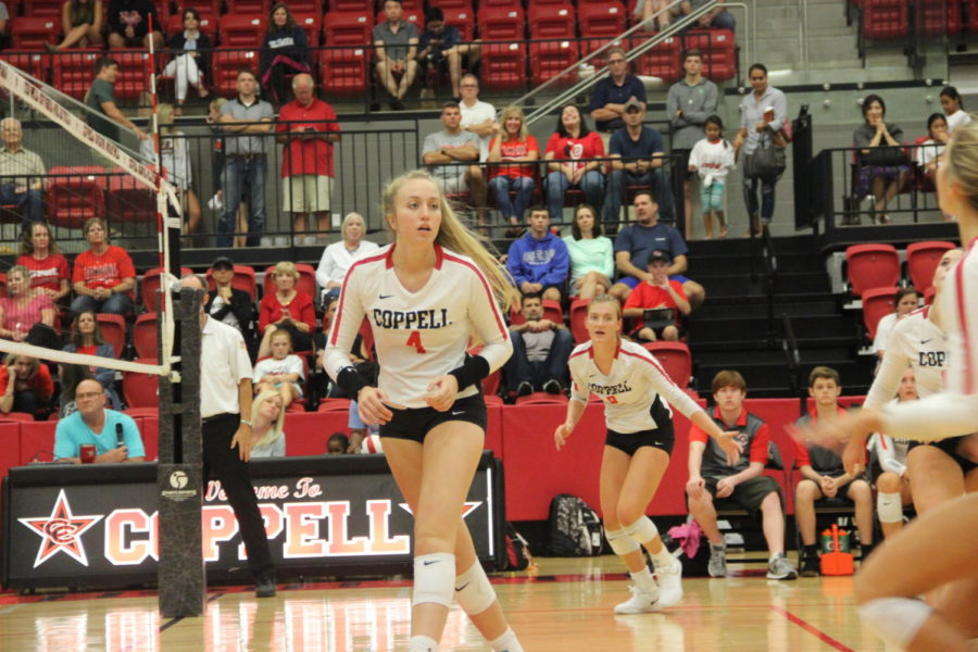 Coppell senior middle blocker Peyton Minyard prepares to hit during Tuesday's match against Arlington Martin in the CHS Arena. The Cowgirls lost to Martin in five sets, 23-25, 26-24, 18-25, 26-24 and 12-15.