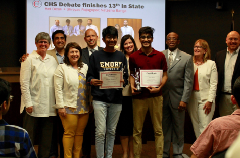 Coppell High School seniors Shreyas Rajagopal and Het Desai are recognized for placing 13th in the National Speech and Debate Tournament in July during Monday's Coppell ISD Board of Trustees meeting at the Vonita White Administration Building. The board also approved the 2019-20 CISD budget. Photo taken by Neveah Jones.