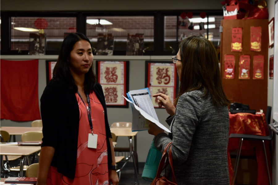 Coppell High School Mandarin/Chinese teacher Andrea Voelker listens to a parent's questions during Open House on Tuesday night. Parents of students at CHS had the opportunity to meet their children's teachers and understand what their classes will be like for the 2019-20 school year.