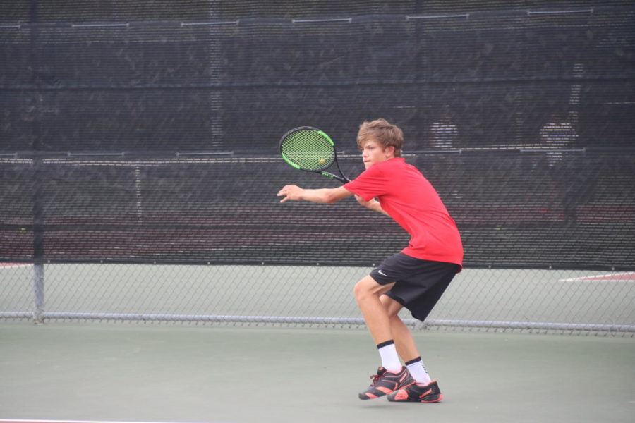 Coppell High School junior Austin Gregory returns a shot against Plano West at the CHS Tennis Center on Friday. Plano West defeated Coppell, 15-4.