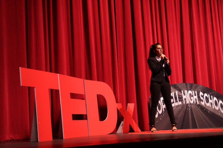"Coppell High School senior Aditi Mutagi discusses the burning of the Amazon rainforest during her TedxYouth Talk at CHS on Wednesday night. The event's theme was ""the world reimagined"", and speech topics ranged from showing gratitude to social media addiction."