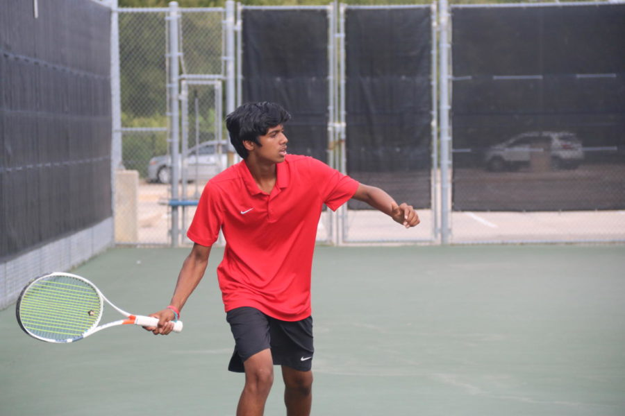 Coppell sophomore Vinay Patel prepares for a shot against Plano West at the Coppell High School Tennis Center on Sept. 13. The Coppell tennis team faces off against both Tyler Lee and Longview this Saturday at 9:30 a.m. and 2:30 p.m., respectively.