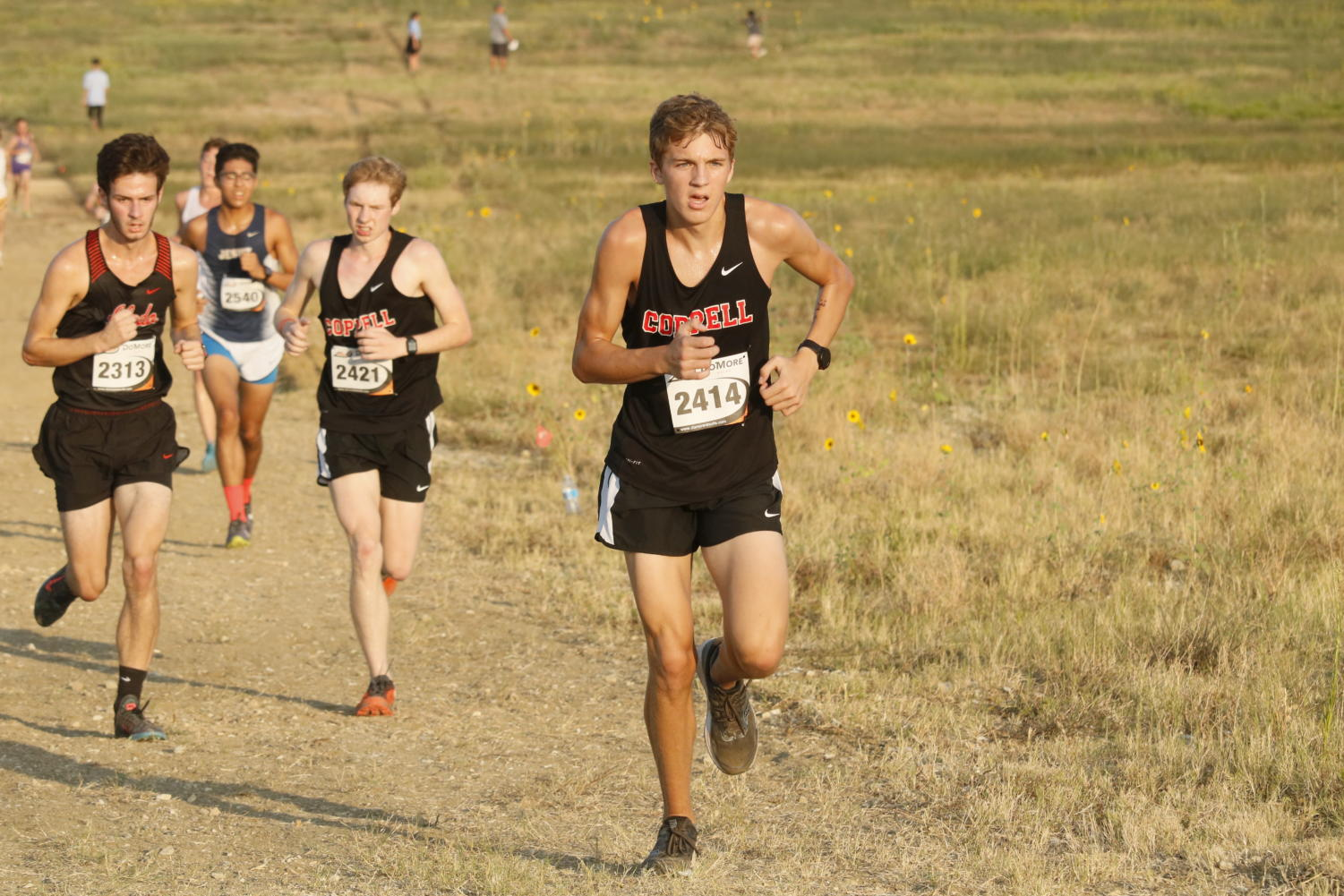 Coppell junior runner Andrew Crichton heads up the last hill on the course at Coppell Middle School West. The elite varsity boys placed fifth on Saturday at their only home meet of the season, the Coppell Invitational.