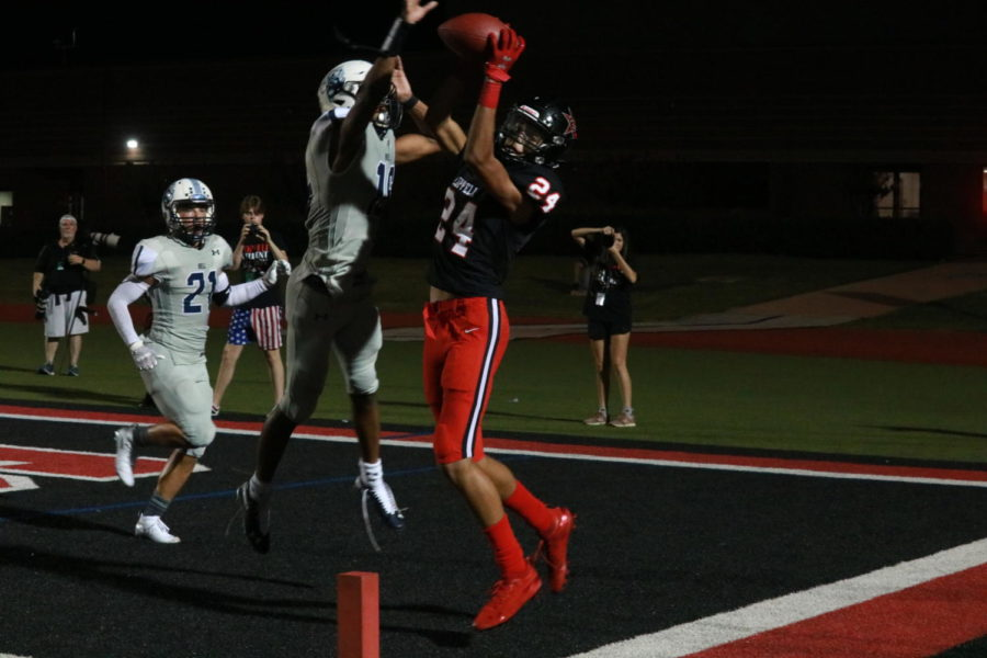 Coppell+sophomore+wide+receiver+Anthony+Black+attempts+to+make+a+catch+in+the+endzone.+The+Cowboys+won+their+first+home+game+of+the+season%2C+17-10%2C+against+L.D.+Bell+on+Friday+night+at+Buddy+Echols+Field.