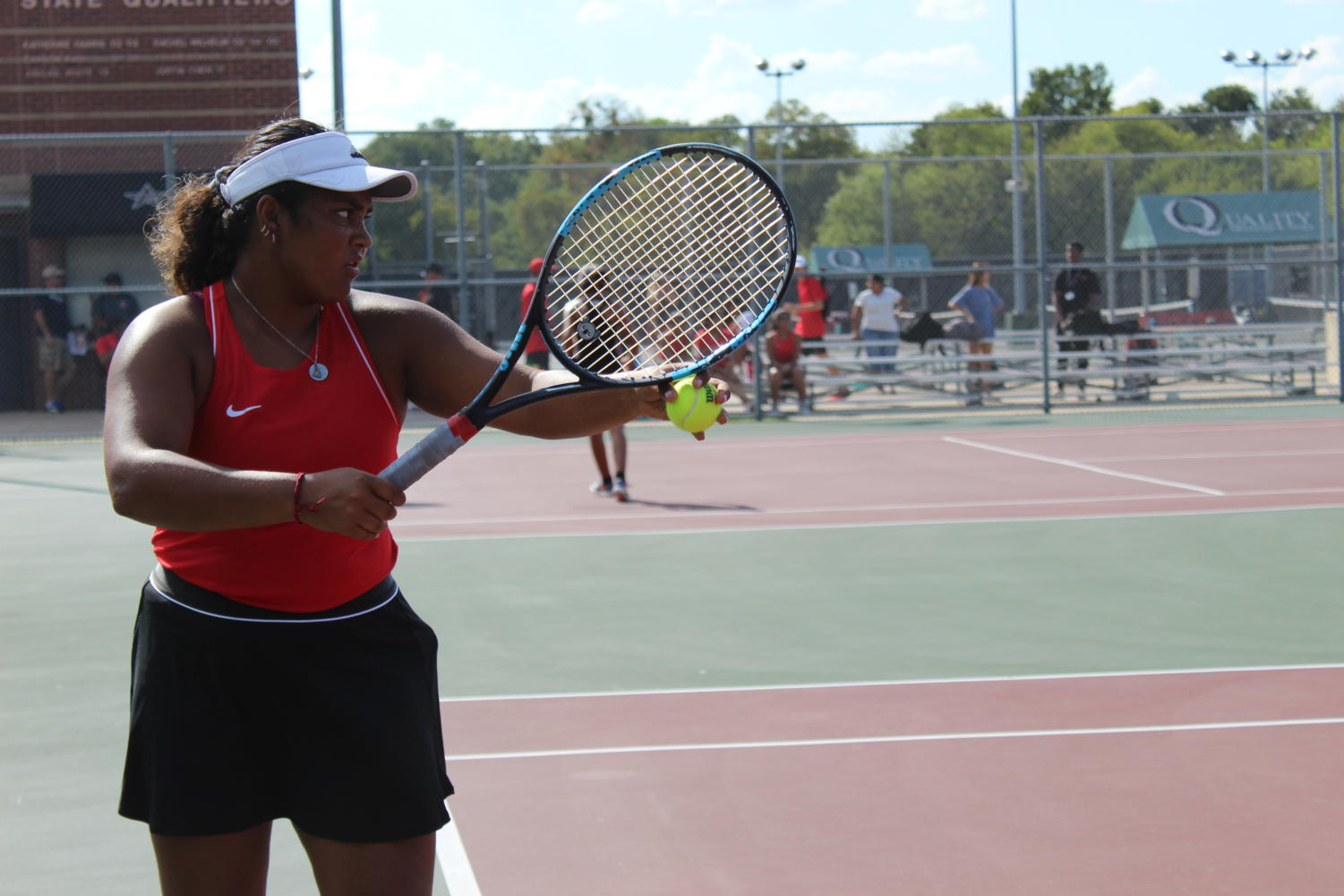 Coppell senior Ruchika Khowala prepares to serve in a District 6-6A match against Lewisville on Sept. 10 at the CHS Tennis Center. Coppell tennis was recently ranked fifth in Class 6A and first in Region I by Texas Tennis Coaches Association (TTCA). Photo by Anthony Onalaja