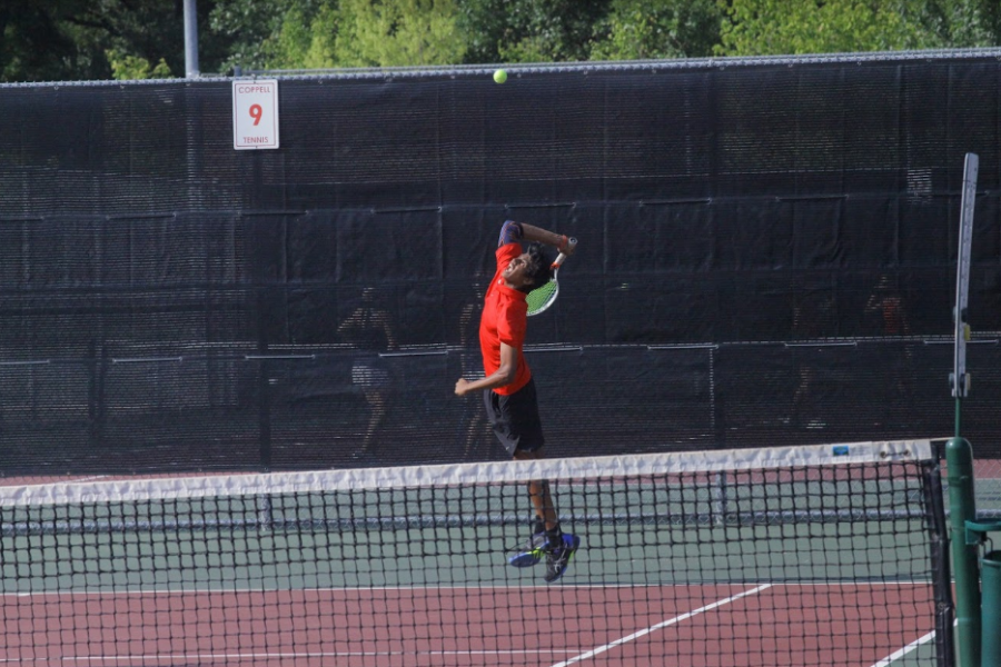 Coppell+tennis+sophomore+Vinay+Patel+plays+a+doubles+match+with+senior+Clark+Parlier+against+Highland+Park+on+Friday+at+the+CHS+Tennis+Center.+Coppell+lost%2C+11-4%2C+and+Highland+Park+remains+undefeated.