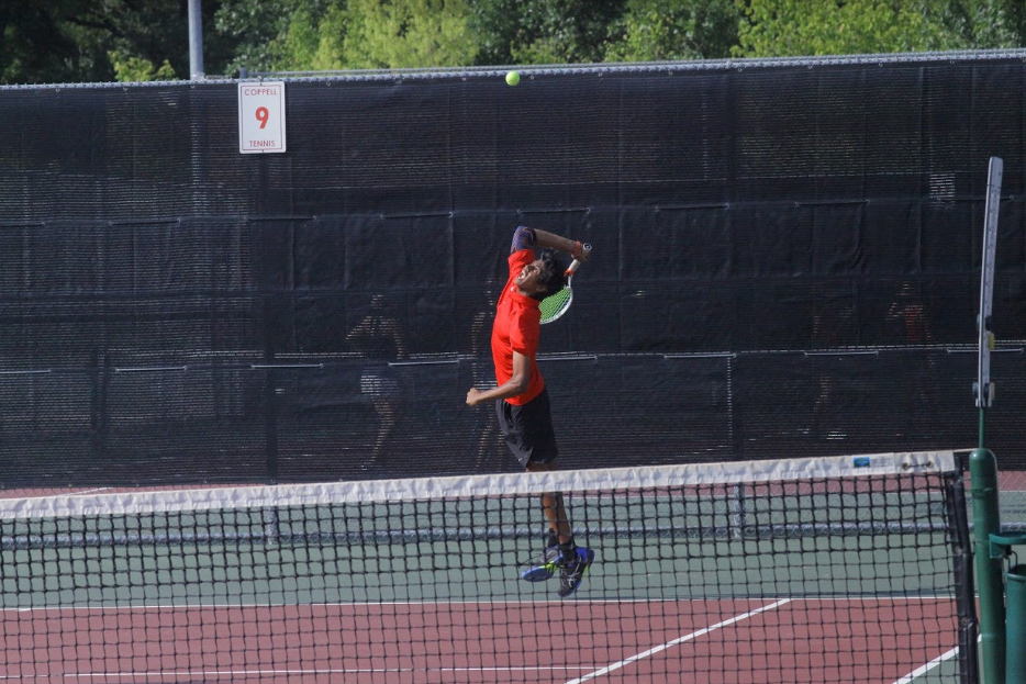 Coppell tennis sophomore Vinay Patel plays a doubles match with senior Clark Parlier against Highland Park on Friday at the CHS Tennis Center. Coppell lost, 11-4, and Highland Park remains undefeated.