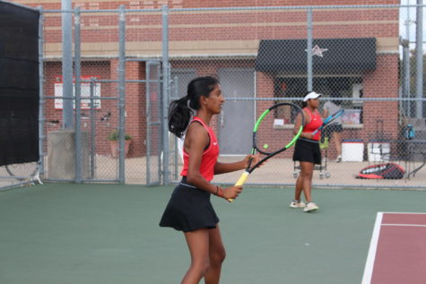 Coppell seniors Aishwarya Kannan and Ruchika Khowala wait to return a shot against Tyler Lee at the Coppell High School Tennis Center on Satuday. The Coppell tennis team defeated Lee, 17-2.