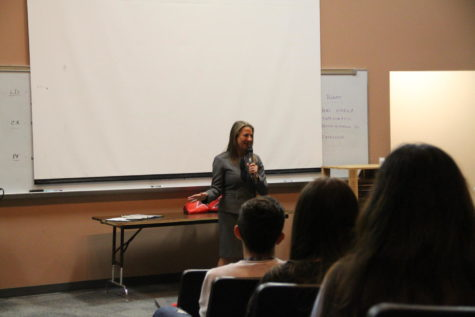 Texas Secretary of State Ruth Hughs speaks to Coppell High School government students in the lecture hall about the importance of registering to vote. Hughs was recently appointed State Senator by Governor Greg Abbott and explained the details of her job to the students.