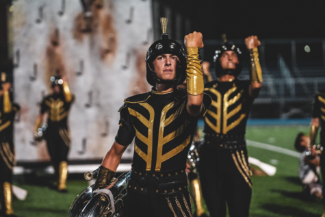 New Tech senior Mason Clark poses for the Boston Crusaders on Aug. 1 in Lawrence, Mass. Clark's outfit is a Crusader, a medieval fighter. Clark wields his tuba in the left hand and the right up in the air. Photo courtesy Mason Clark
