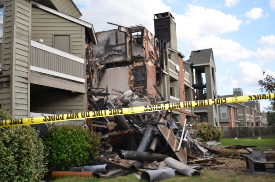 Apartment+building+8821+at+Reflections+at+Valley+Ranch+is+fenced+off+from+the+rest+of+the+complex.+On+Saturday%2C+a+fire+destroyed+all+13+of+8821%E2%80%99s+units%2C+showing+extensive+damage+and+financial+costs.+