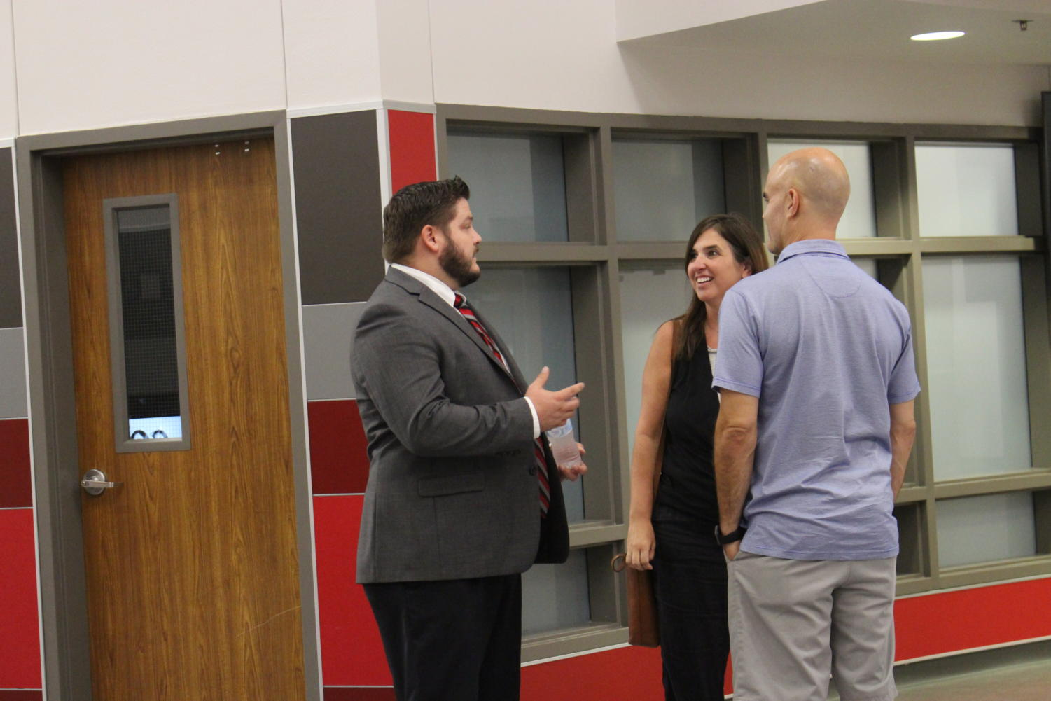 CHS9+Principal+Cody+Koontz+introduces+himself+to+freshman+parents+at+Curriculum+Night+near+the+main+entrance.+CHS9+Curriculum+Night+took+place+on+Tuesday+from+6-8+p.m.