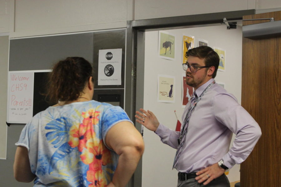 CHS9 English teacher Christopher Arney talks to a parent at Open House on Sept. 3. Arney is new to the campus for the 2019-20 school year.