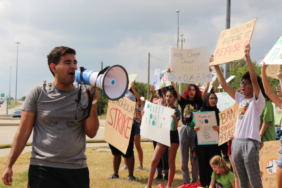 Collin College sophomore Chris Vasquez rallies the crowd in their protest for climate action on Saturday at the Collin County Courthouse in McKinney. The strike was organized by a local chapter of Zero Hour, a youth-led movement seeking action to protect the planet from climate change.
