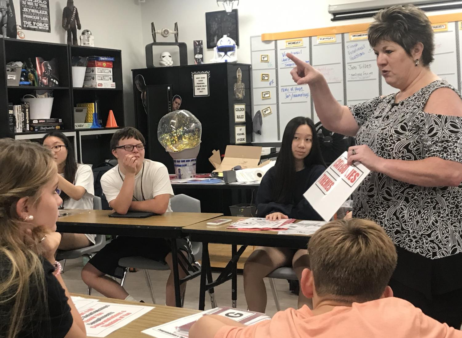 Coppell High School special education teacher Melissa Murray gives directions to her seventh period Applied Vocational Experience class about the next preparation phase of their business and year-long class project called A Note of Hope. This business provides a service where CISD students can send anyone kind, uniquely designed notes for free.