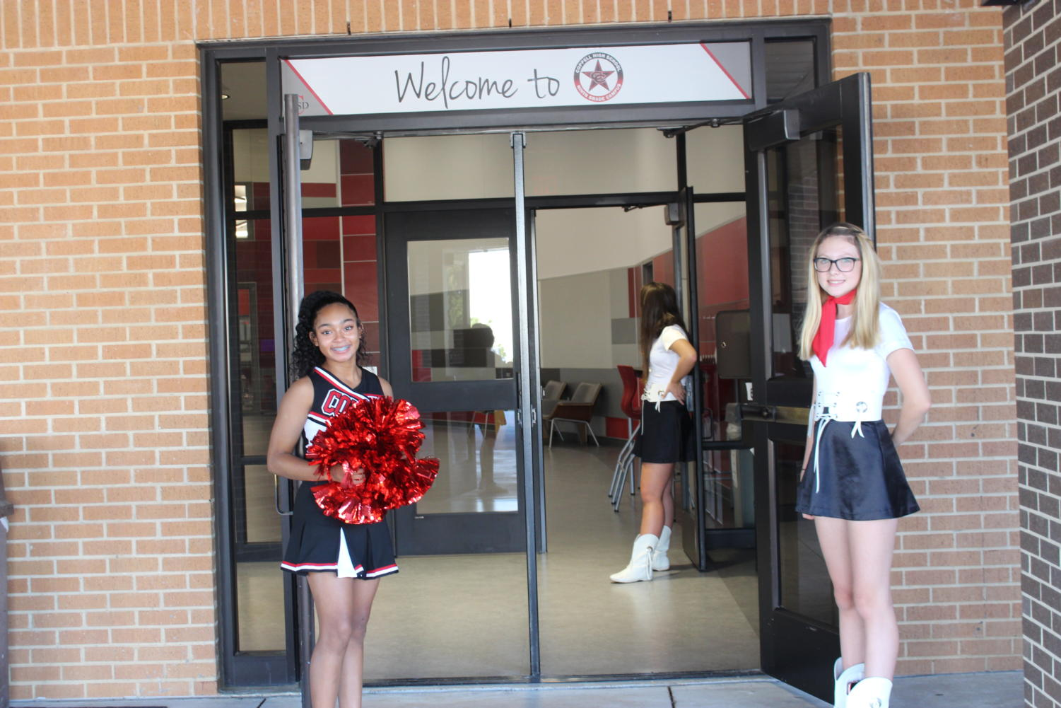 Freshmen+cheerleaders+and+Silver+Stars+greet+parents+as+they+arrive+at+the+CHS9+campus.+CHS9+Curriculum+Night+took+place+on+Tuesday+from+6-8+p.m.