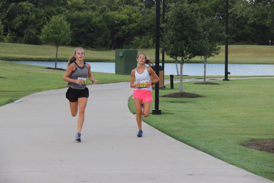 Race participants finish their last lap of the Fighting Autoimmunity Disease 5K run on Saturday, Aug. 31. The charity run aimed to raise awareness in the community and money for autoimmunity disease research and organizations.
