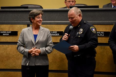 Coppell Mayor Karen Hunt listens to Coppell Police Chief Danny Barton talk about upcoming National Night Out on Oct. 1 during the Coppell City Council meeting on Tuesday at Town Center. The city also approved Hunt's candidacy for president-elect of the Texas Municipal League.