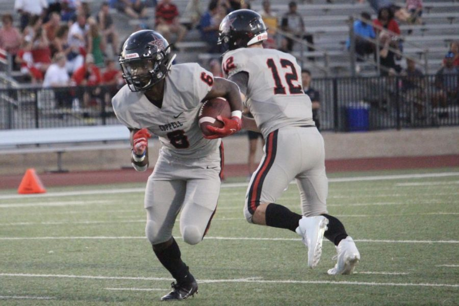 Coppell+junior+running+back+Jason+Ngwu+runs+for+a+touchdown+on+Friday+at+Joy+and+Ralph+Ellis+Stadium+in+Irving.+Coppell+defeated+MacArthur%2C+42-6.+