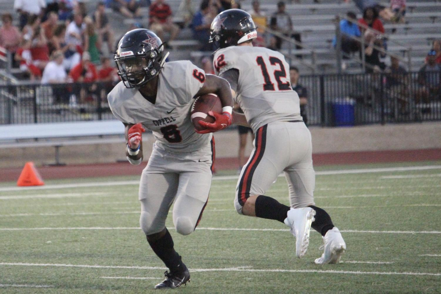 Coppell junior running back Jason Ngwu runs for a touchdown on Friday at Joy and Ralph Ellis Stadium in Irving. Coppell defeated MacArthur, 42-6.