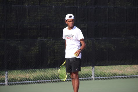 Coppell junior Kunal Seetha serves at the CHS Tennis Courts on Tuesday against Hebron during his match, a 7-6, 6-2 victory. Coppell defeated the Hawks, 13-6, in District 6-6A team tennis.