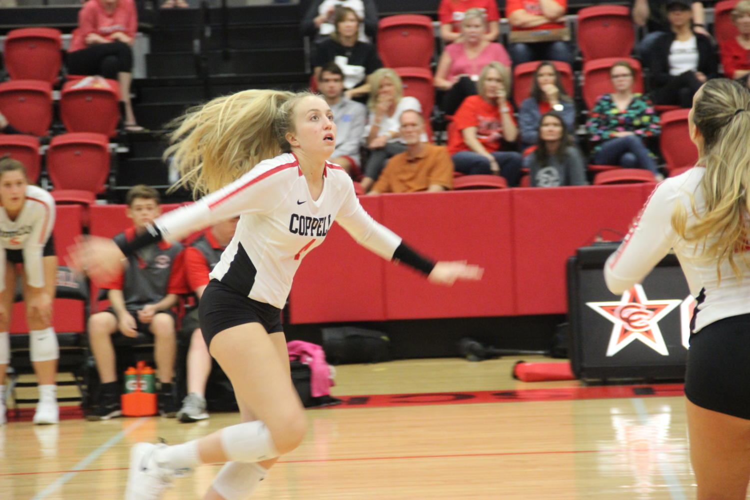 Coppell senior Peyton Minyard prepares to spike during the match against Arlington Martin on Aug. 27 in the CHS Arena. Minyard committed to Boston College and will receive a volleyball scholarship.