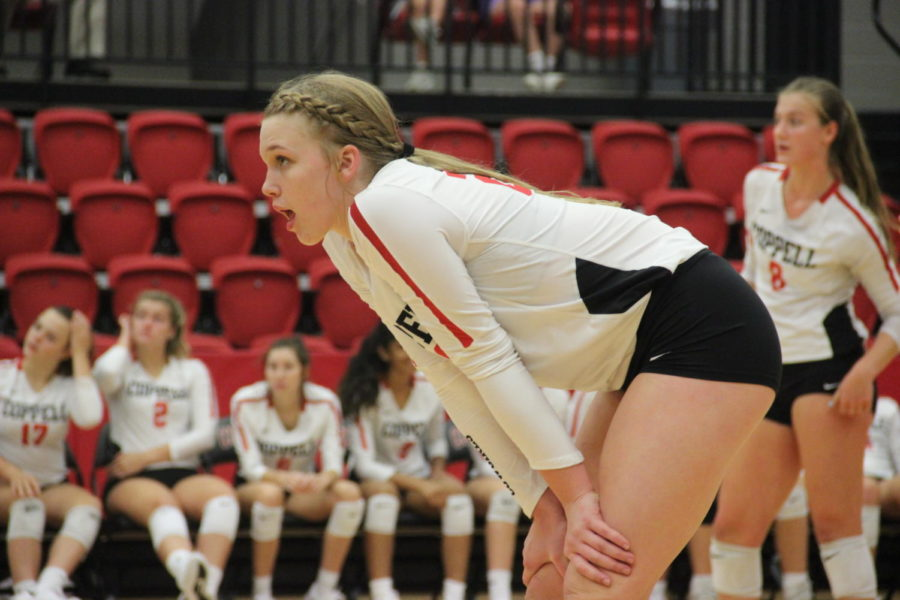 Coppell freshman Reagan Engler awaits a serve during the match against Arlington Martin on Aug. 27 in the CHS Arena. Engler was coached by her mother, Coppell Middle School North coach Abby Martens in seventh and eighth grade and now plays for the Coppell varsity team.