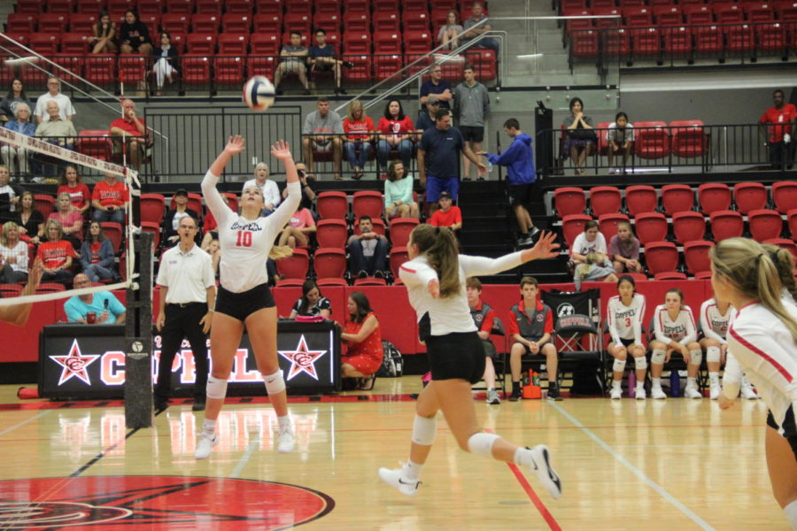 Coppell senior Kinsey Bailey sets to junior Madison Gilliland during a preseason match against Arlington Martin on Aug. 13 in the CHS Arena. The Cowgirls face Irving Nimitz tonight at 6:30 p.m. at the CHS Arena in its District 6-6A opening match.