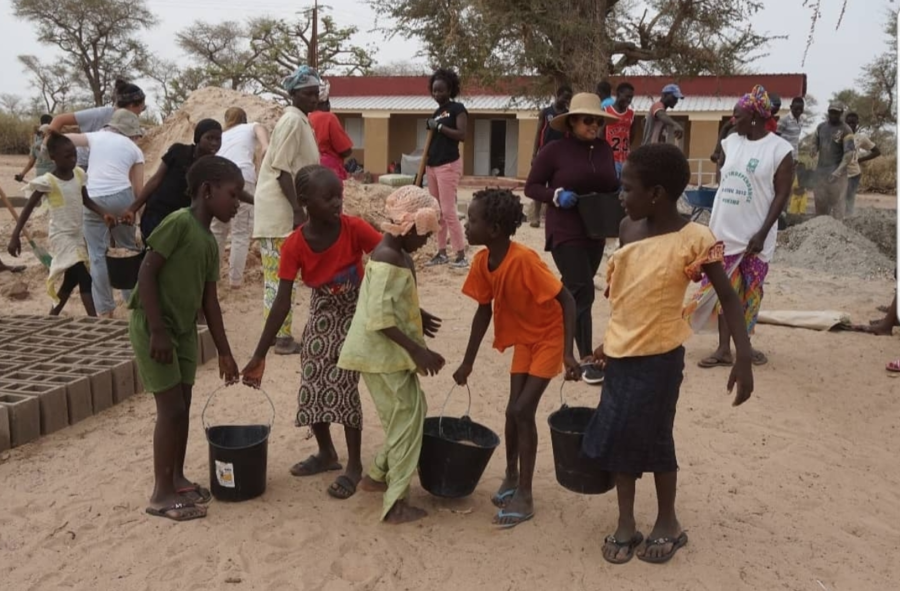 Senegalese+children+carry+raw+materials+in+buckets+to+help+the+construction+of+their+future+school.+The+buildOn+organization+raises+funds+and+helps+build+schools+in+areas+across+the+world+that+are+in+need.+Photo+courtesy+Ananya+Pagadala.