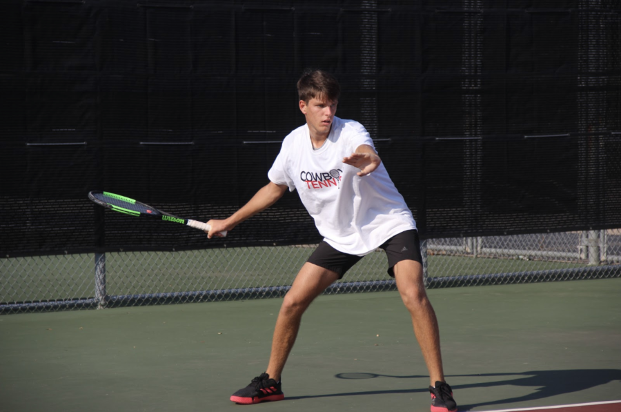 Coppell+junior+Andreja+Zrnic+gets+into+position+at+the+CHS+Tennis+Center+during+a+match+against+Hebron+on+Sept.+3.+Zrnic+has+played+tennis+for+eight+years%2C+training+at+school%2C+with+his+family+members+and+with+world-ranked+players.