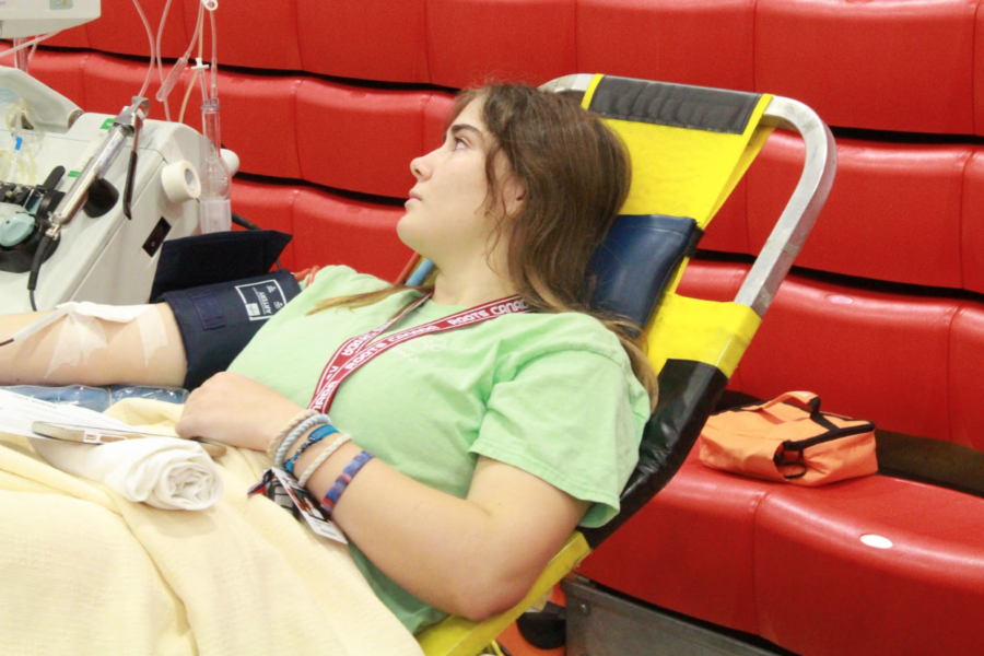 Coppell+High+School+junior+Gillian+Pernot+gets+her+blood+drawn+during+second+period+in+the+small+gym+on+Friday.+Students+and+faculty+were+able+to+sign+up+to+donate+blood+through+the+HOSA+blood+drive+today.