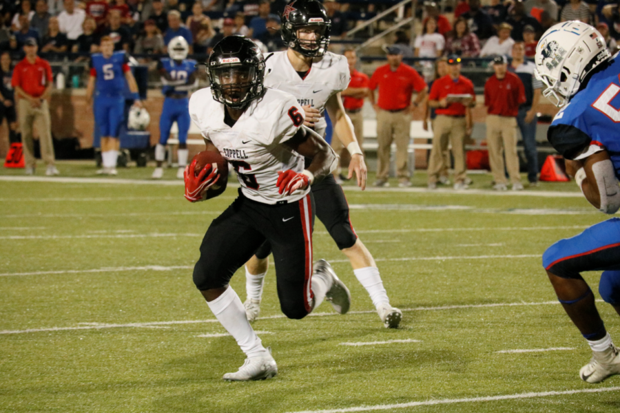 Coppell+senior+running+back+Cam+Williams+rushes+against+Allen+at+Eagles+Stadium+on+Sept.+13.+The+Cowboys+travel+to+Joy+and+Ralph+Ellis+Stadium+to+face+MacArthur+in+their+first+District+6-6A+game+tonight+at+7+p.m.