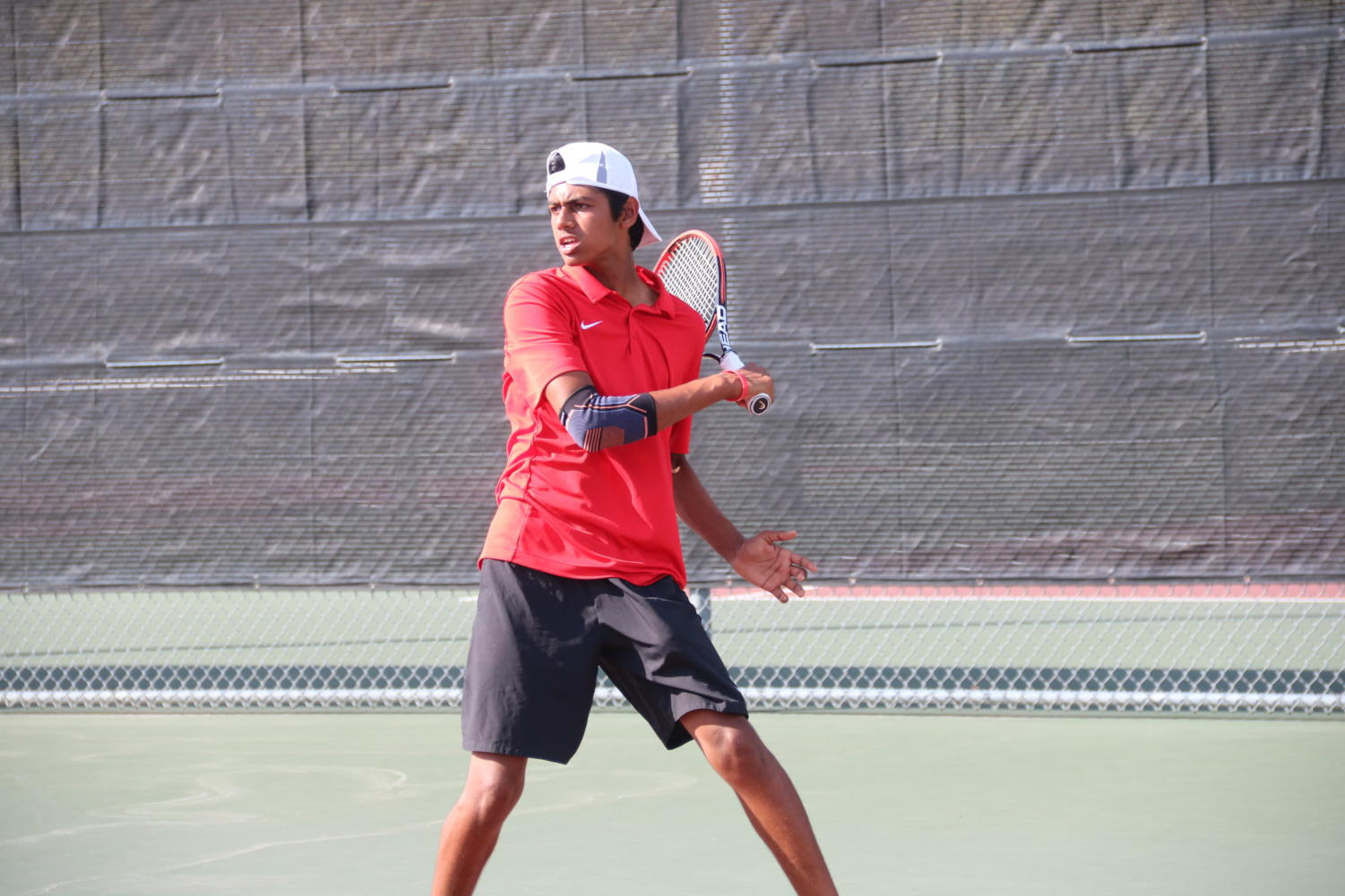 Coppell sophomore Vinay Patel prepares for a return against Longview at the Coppell High School Tennis Center on Saturday. Coppell defeated Longview, 17-2.